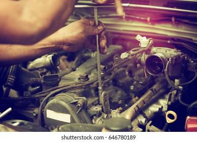 The hand is repairing the piston engine.