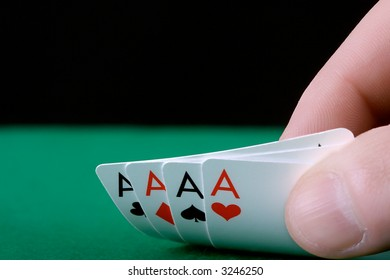 Player's hand revealing Four Aces