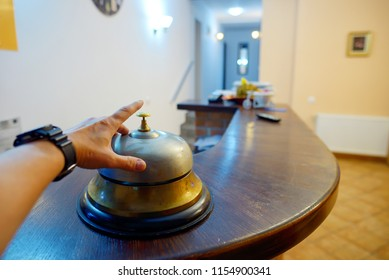 Hand ringing in service bell at hotel