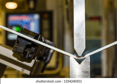 Hand robot working automatic cutting and bending metal sheet. operator bending metal sheet by sheet bending machine