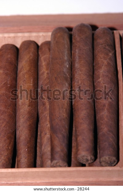 hand rolled cigars sit in a box for the next person to pick on out to smoke