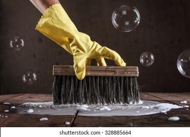 7/8/18-7/14/18 Hand-rubber-glove-scrubbing-wooden-260nw-328885664