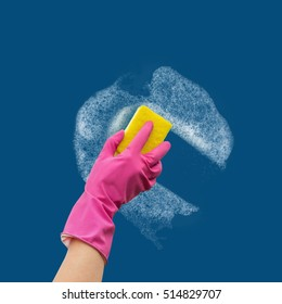 Hand in rubber glove washes the wall cleaner.
