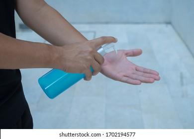 Hand sanitizer alcohol gel rub clean hands hygiene prevention of coronavirus virus outbreak. Man using bottle of antibacterial sanitiser soap.