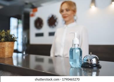 Hand sanitizer bottle on hotel reception desk