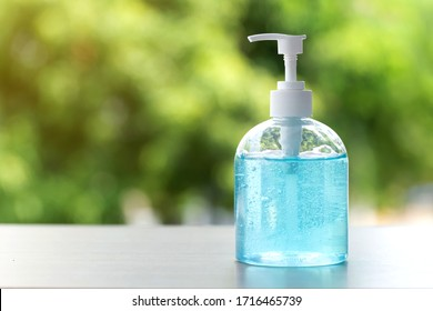 hand sanitizer gel for hand hygiene on green background, health care concept.corona virus protection.