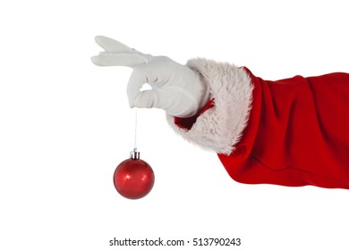 Hand of santa claus holding christmas bauble against white background