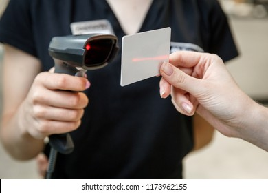 Hand scanning barcode on member card with credit card reader