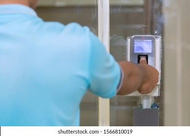 The hand are scanning on fingerprint machine for enter digital security door system in the office building at Bangkok ,Thailand.  Fingerscan with access control on the glass door.