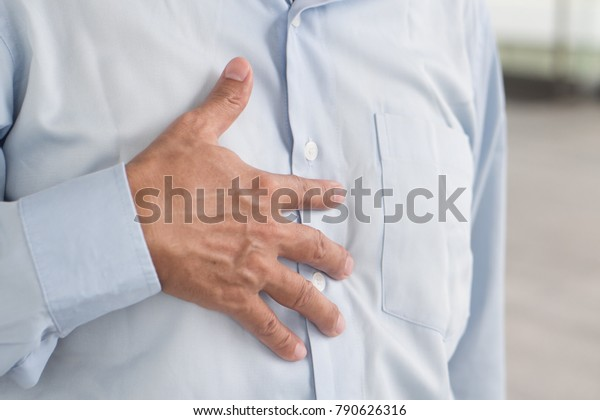 hand of senior old man holding acid reflux, esophagus cancer chest