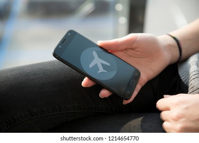 Hand setting the flight mode to the smartphone before taking off for security reasons