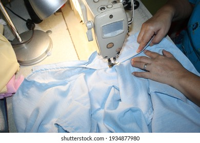 Hand Sewer Busy Hour on Working While Perform Work of Uniform Stitching Clothe
