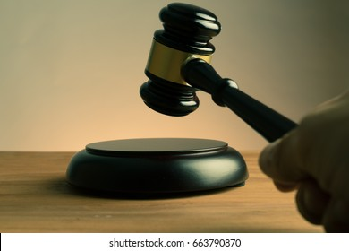 hand shake auction or scene of lawyers or notaries with gavel judge for the insurance compensations. concept of law and lawyer, judiciary and legislature applied to the democratic law.