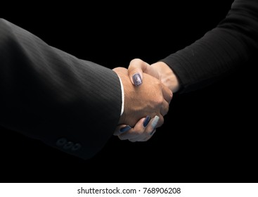 Hand shake between a business man and a business woman isolated on black background