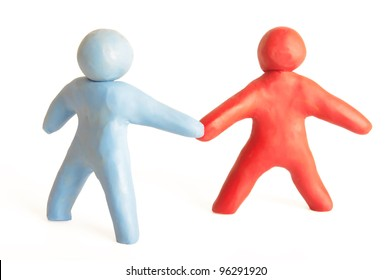 Hand shake between a two human figures from plasticine