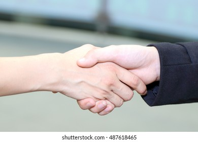 Hand shake man woman introduce greetings outdoor