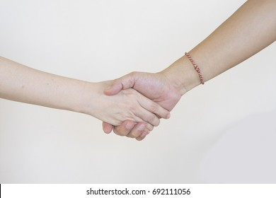 Hand shaking of woman and man with white background.