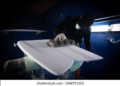 Hand shaper shaping a surfboard