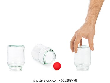 Hand and shell game with glass cans isolated on white background