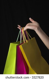 hand and shopping bags over black drop