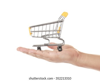 hand and shopping cart isolated on white background