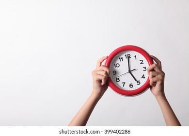 hand show the red clock on white background