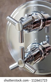 hand shower equipment on brown wall of bathroom