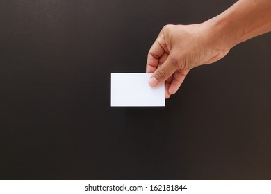 Hand showing the blank business card isolated in black