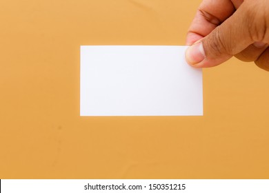 Hand showing blank namecard on yellow background