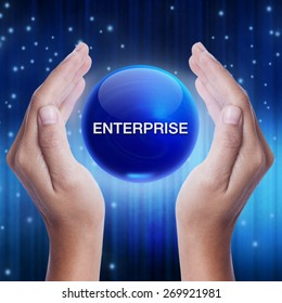 Hand showing blue crystal ball with enterprise word. business concept