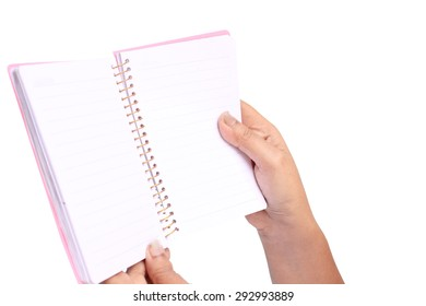 hand is showing a book on white background