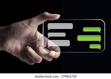 Hand showing chat bubbles on transparent 3D smartphone with black background.