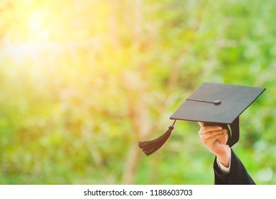 Hand showing Graduate hat. Concept sucess education in University