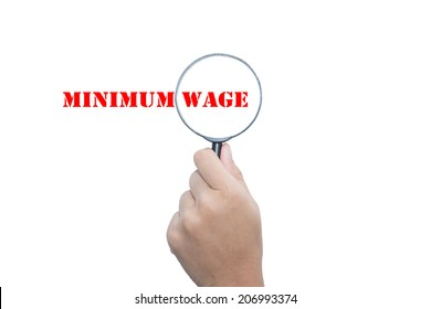 Hand Showing MINIMUM WAGE   Magnifying Glass