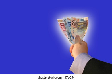 a hand showing money on blue background. the banknotes are surrounded by a glowing edge