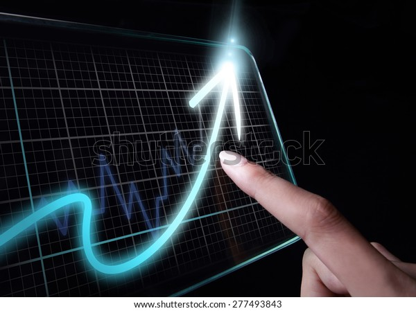 Hand showing a rising graph on tablet, representing business growth. The background is black, chart colors are white and blue.