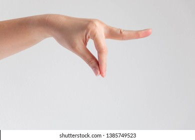 A hand showing thumb and forefinger touch together and others forward; posture like holding at end of object; or catching something dirty with disgusting; or posture let out flavor powder of chef.