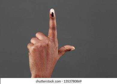Hand shows finger with electoral stain.