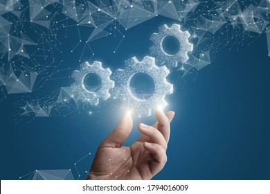 The hand shows gears on a blue background.