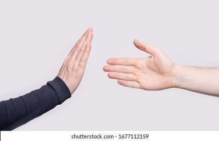 The hand shows gesture the stop to the handshake. Concept of prevention of infection spreading. Covid-19. Corona virus outbreak.