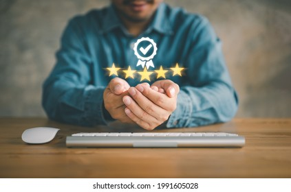 Hand shows the sign of the top service Quality assurance 5 star, Guarantee, Standards, ISO certification and standardization concept.