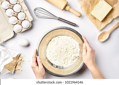 Hand sift flour. Bakery prepare for make cake. Top view