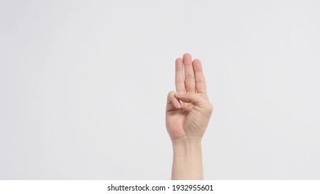 A hand sign of 3 fingers point upward meaning three, third or use in protest.It put on white background