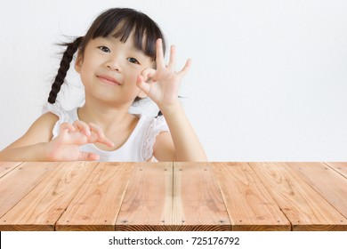 Hand sign for O.K. from Asian kid.