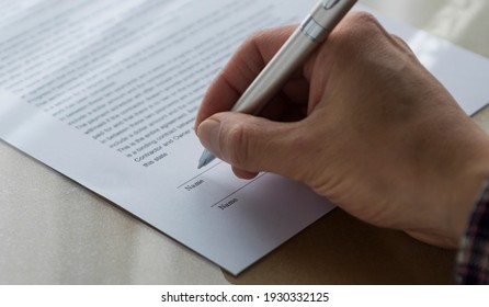 Hand signing a document. Agreement. Contract.