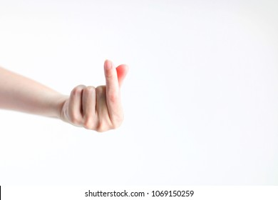 Hand signs gesture little heart from tip of thumb and index finger.