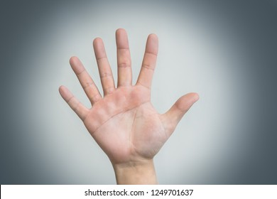 hand with six fingers, human mutation, not like everyone else, strange man, evolution. concept