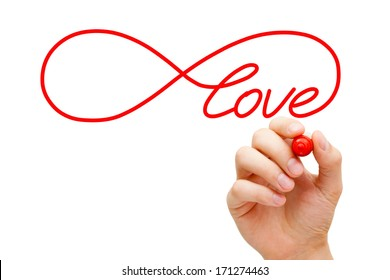 Hand sketching Infinity Love symbol with red marker on transparent wipe board. Concept about finding the endless love.