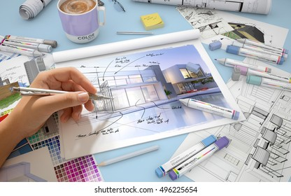 Hand sketching on an architect desktop with a house render, markers and  color swatches