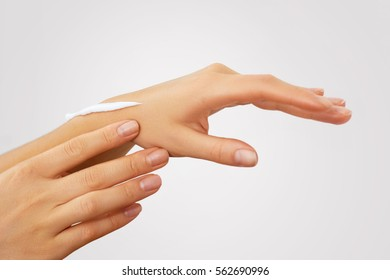 Hand Skin Care. Close Up Of Female Hands Applying Cream, Lotion. Beautiful Woman Hands With Red Manicure.  Applying Cosmetic Hand Cream. Healthy Skin.